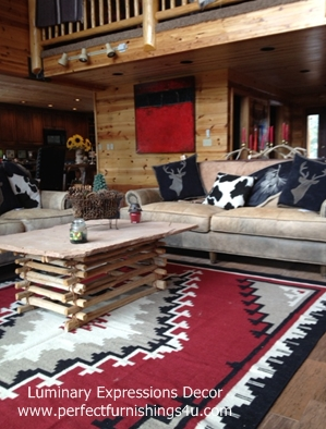 Red Two Grey Hills Ganado wool rug in rustic cabin